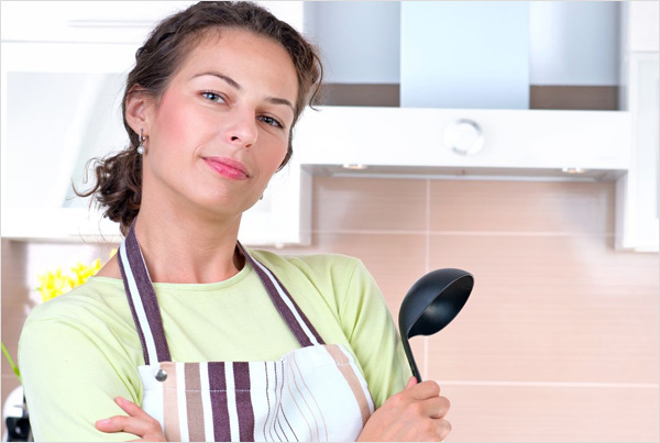 Young woman cooking traditional healthy food in kitchen - Allison Madl, Certified Nutritional Therapy Practitioner - Weight Management